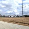 Washington Parish 911 Communications Tower, Sheridan, LA: Construction of a 400 foot tall guyed solid steel triangular tower and associated pre-cast concrete communications equipment buildings.