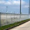 New Orleans Lakefront Airport  Hurricane Katrina Damage Repair - Security Fence, Gates and Cameras: Project included the repair and replacement of storm damaged security fence and gates, installation of new security fence and gates, upgrade airfield access control and install new CCTV monitors.